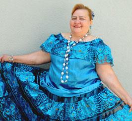 Maria del Carmen Flores wearing a blue dress.